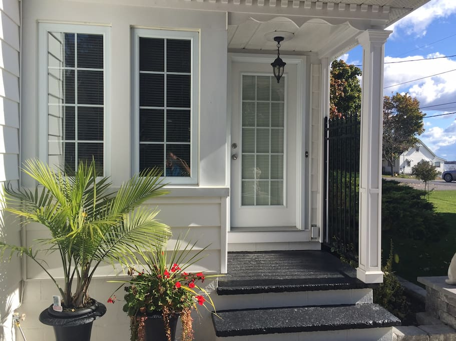 Beautiful front entry with West Lake across the road.