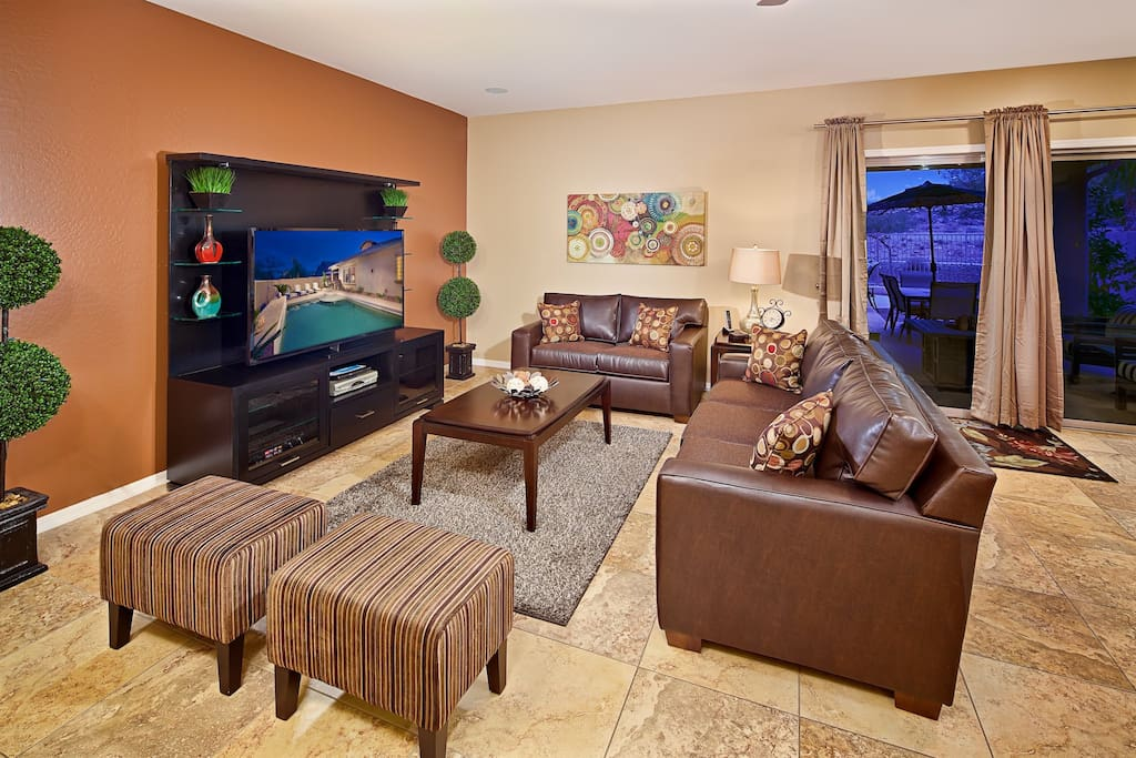 Spacious living room with huge HD TV and plenty of seating!