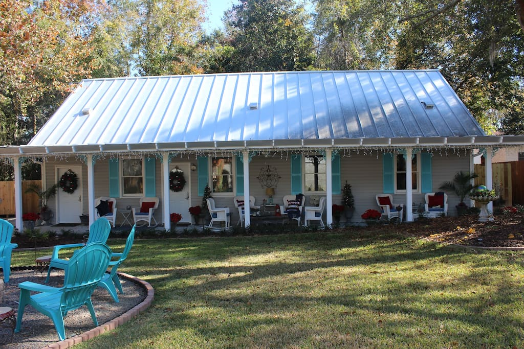 The Cottage is found through the backyard and houses two bedrooms:  Driftwood and Sawgrass