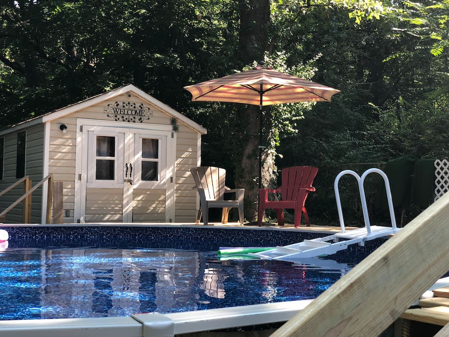 Tiny house with access to the home's Above ground 24' pool.