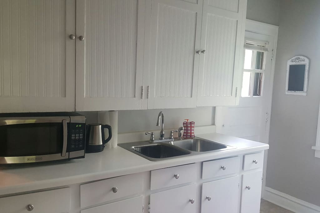 Full kitchen (includes full sized refrigerator, microwave, full sized oven with electric range top, Keurig, tea kettle, and double sink. Full set of dishes, silverware, and cookware available.)