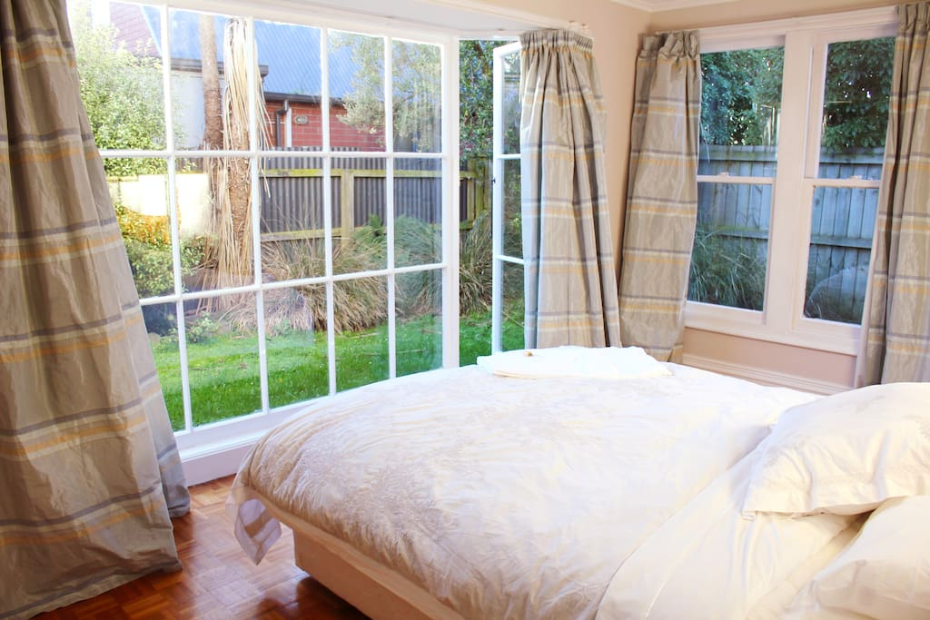 View of native garden from bedroom, comfortable bed with electric blanket