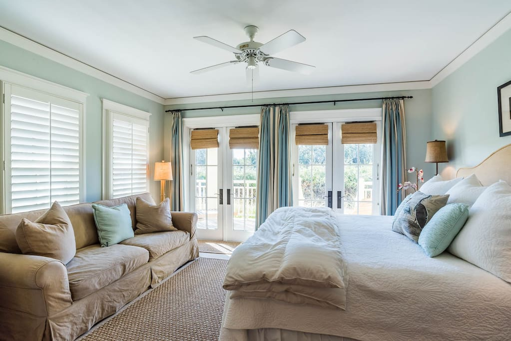 1st Floor Master retreat with a king sized bed and sofa. French doors lead to a private patio