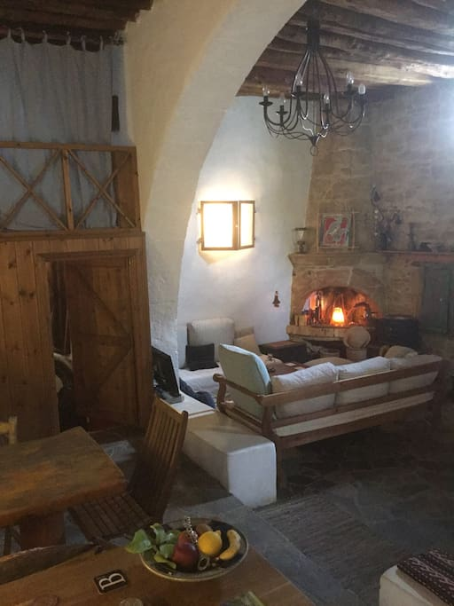 View from kitchen to lounge & workimg fireplace
