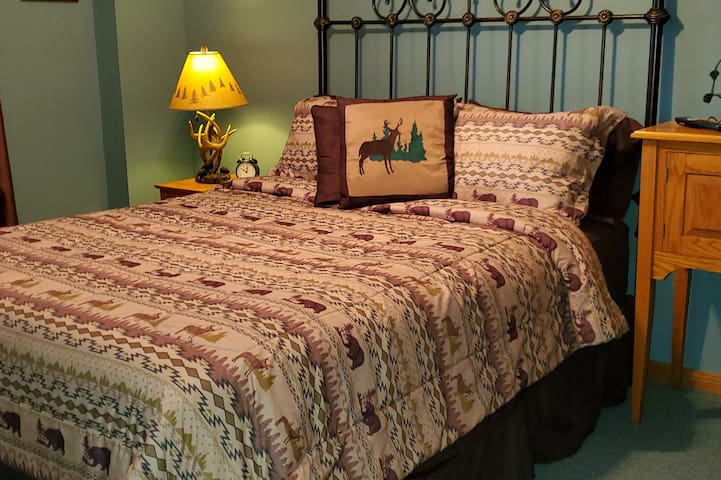 Queen size bed with flat screen tv.  Bedroom has air conditioning in summer.