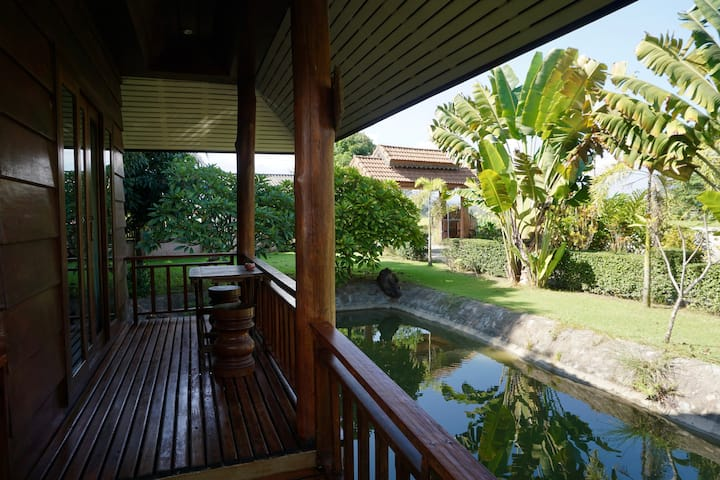 Calm & Cozy Fish Pond Bungalow at Blue Sky Resort