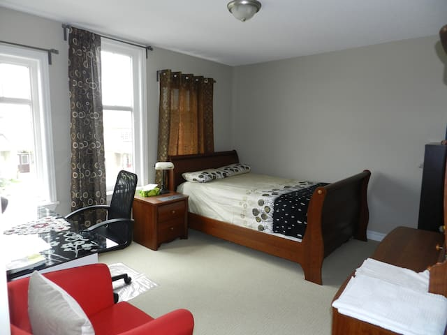 Clean room with an attached bath, with parking