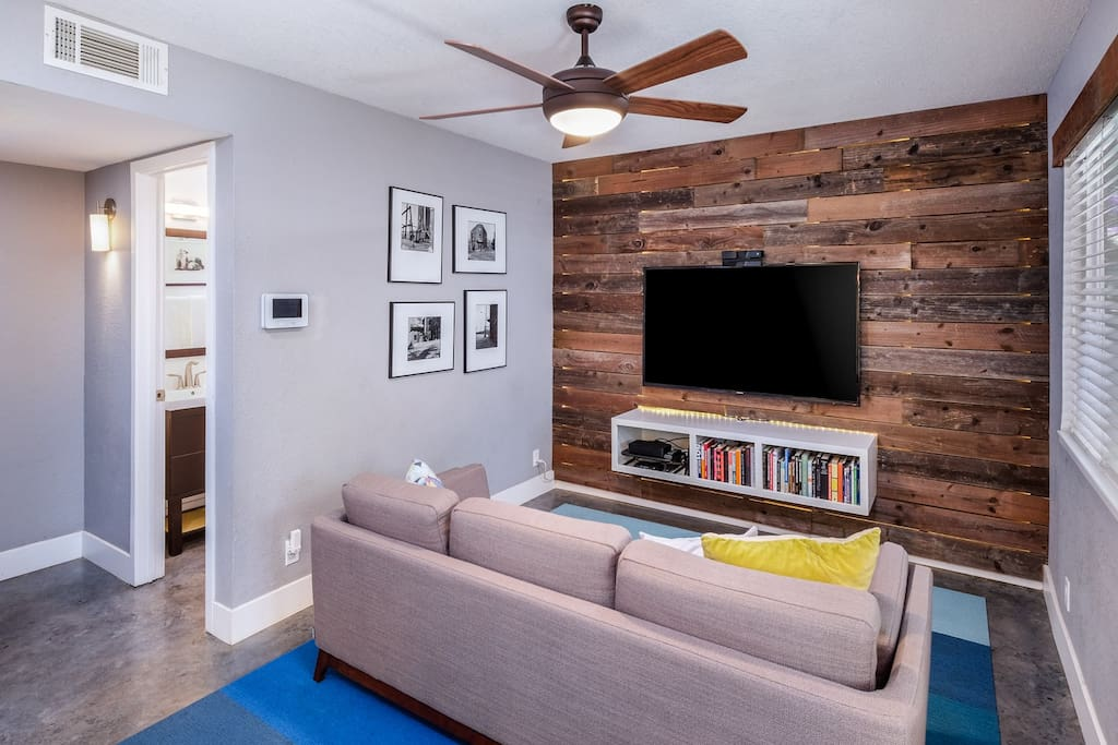 """The living room has a 60"""" HDTV with premium cable and high-speed internet."""