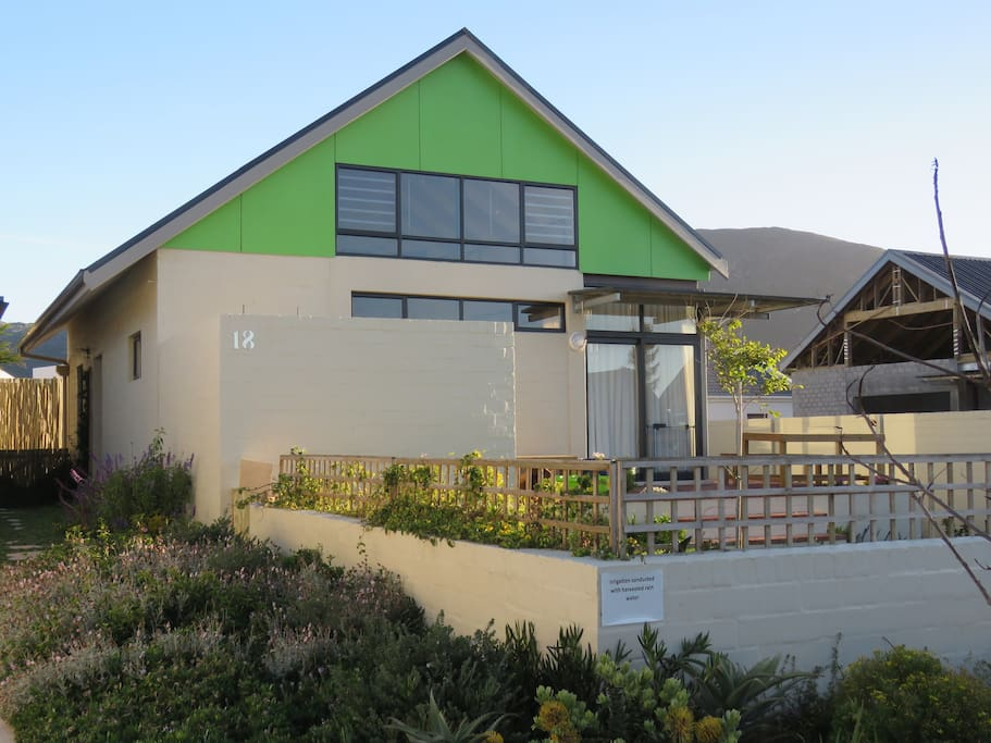 Front view showing fynbos on sidewalk (neighbouring house now completed)