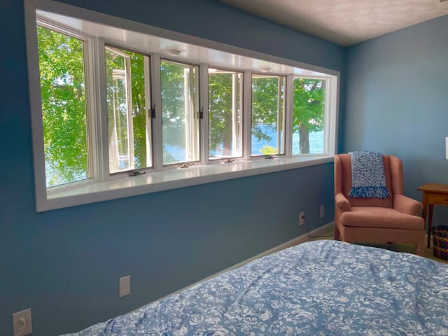 Master bedroom with a desk and work area. New king bed. 7 window with lake views.  Lovely breeze off the lake