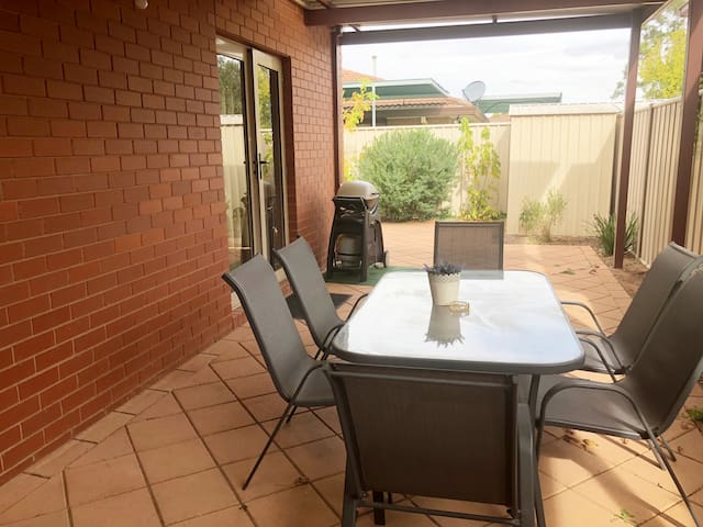Great out door area  Table for 6. Family size webber for a  delicious BBQ