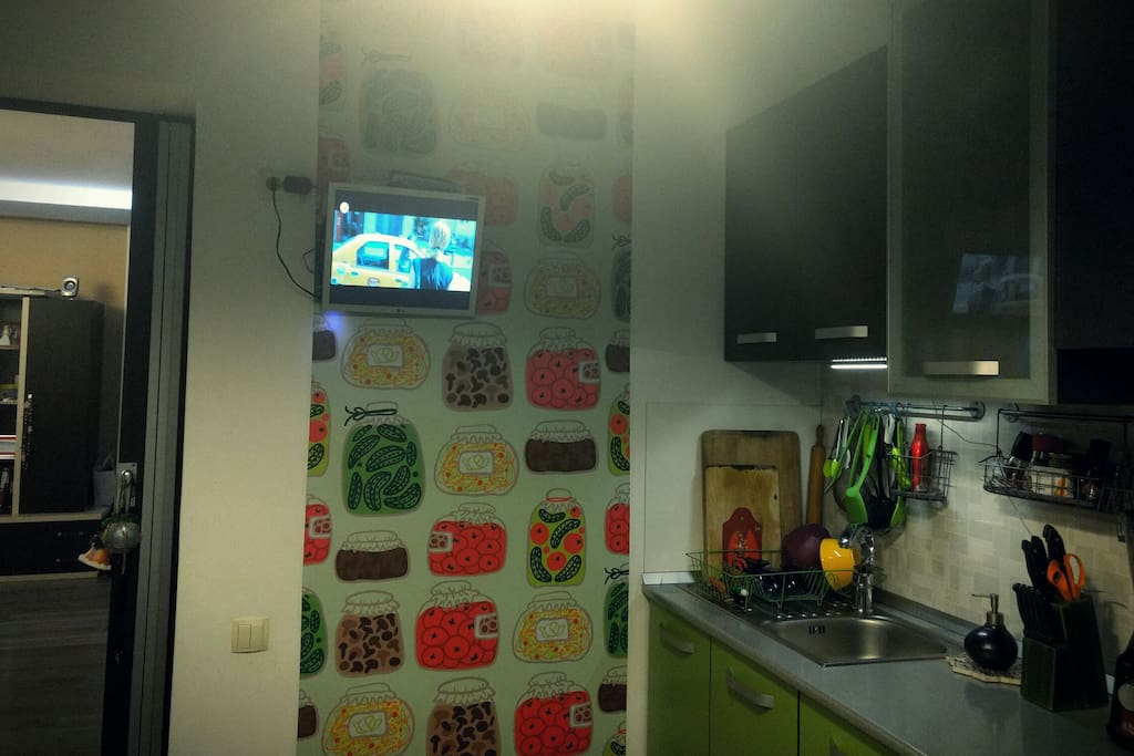 Fully equipped kitchen where you can enjoy your meal while watching TV.