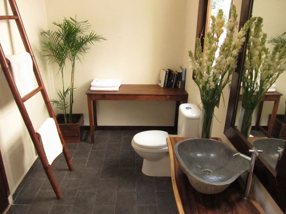 Stoned wash basin and cozy bath deco room with hot and cold water