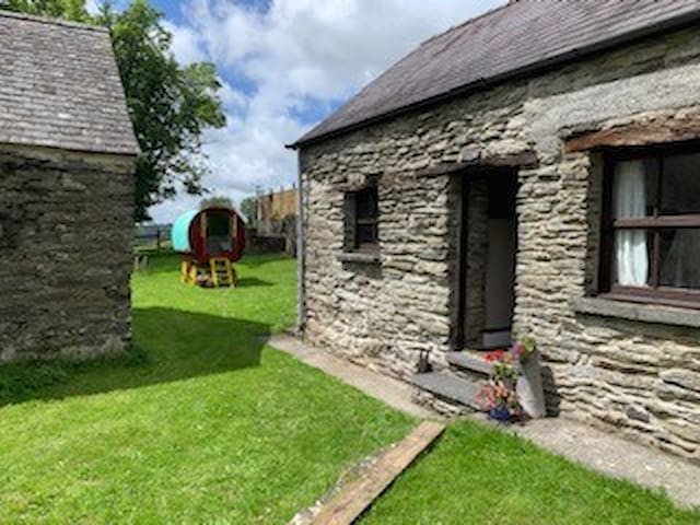 A cottage and gypsy caravan combination holiday
