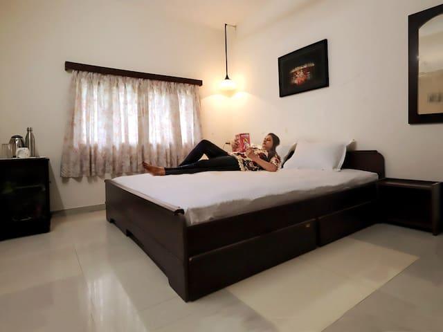 Shri's home | A nice AC room & veranda nr. IIM