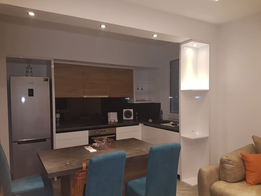 Fully equipped open plan kitchen with dining area