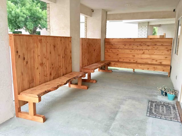 Lovely enclosed patio area created using wood from local trees that died due to the drought in 2017.