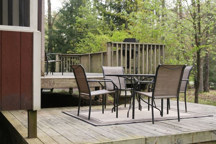 Lower tier of the outdoor deck, complete with 4-person dining area.
