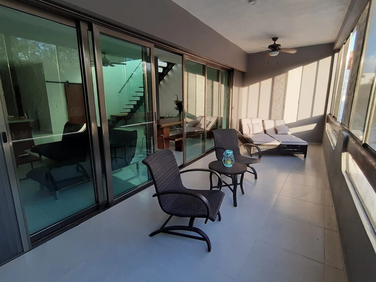 Another view of the over-sized balcony. The balcony has two lounge chairs, that are comfortable enough to take delicious nap or enjoy a good book. This inside/outside space is truly one of the best features.