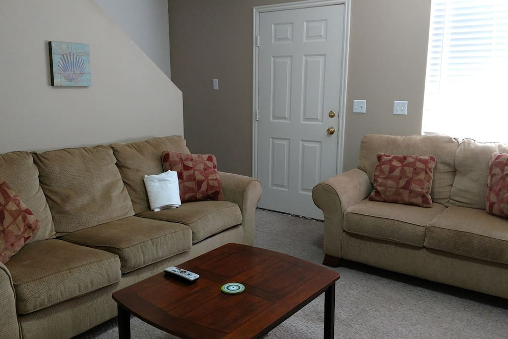 Other side of family room with sofa sleeper