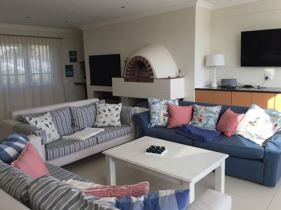 Top floor entertainment area with bar, pizza oven, indoor braai and balcony with sea views