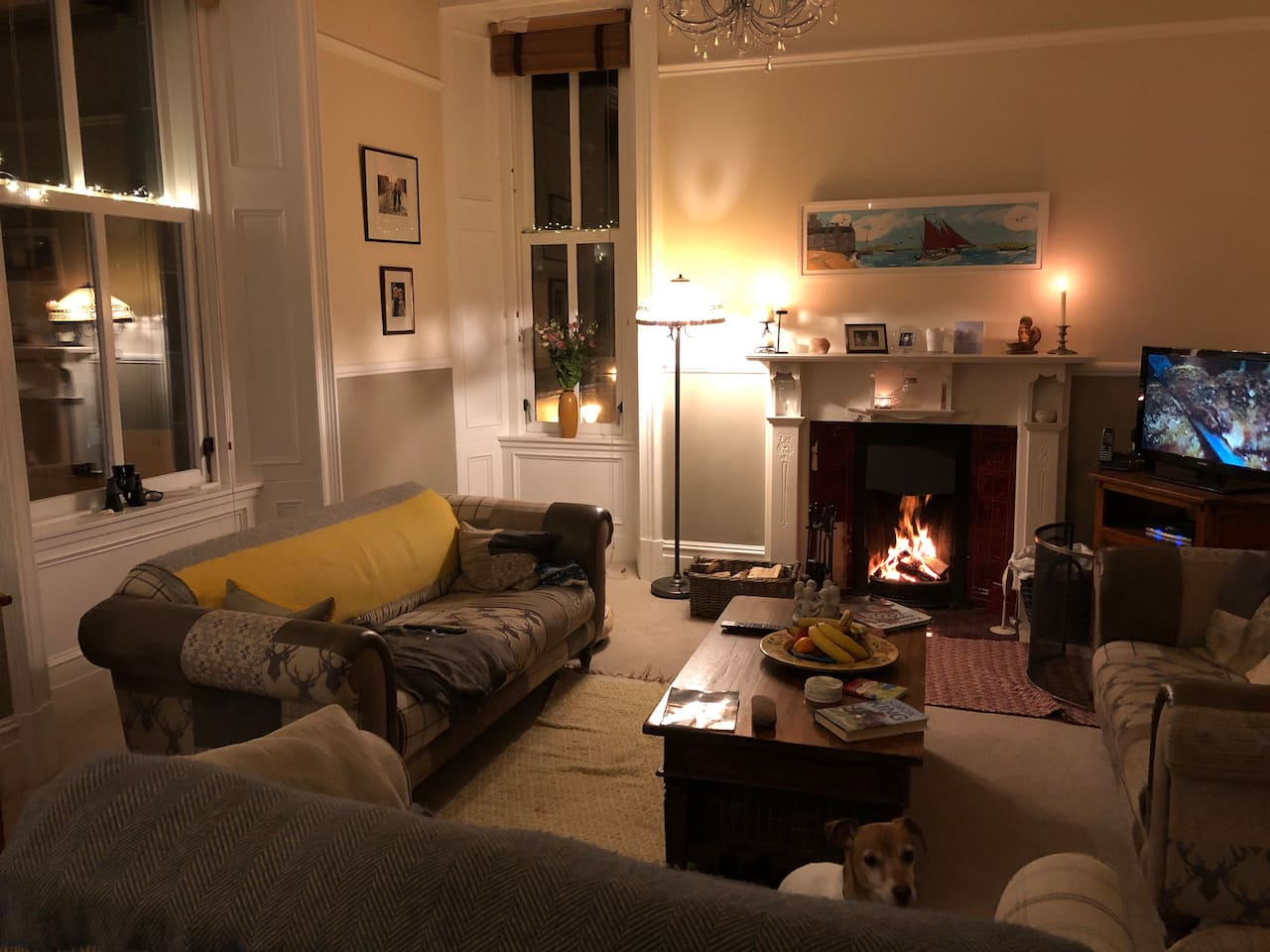 This is the living area with open fire and stunning views across to Bressay. Guests are invited to join us for a glass of wine in the evening or if they just wish a quiet place to read/work during the day.