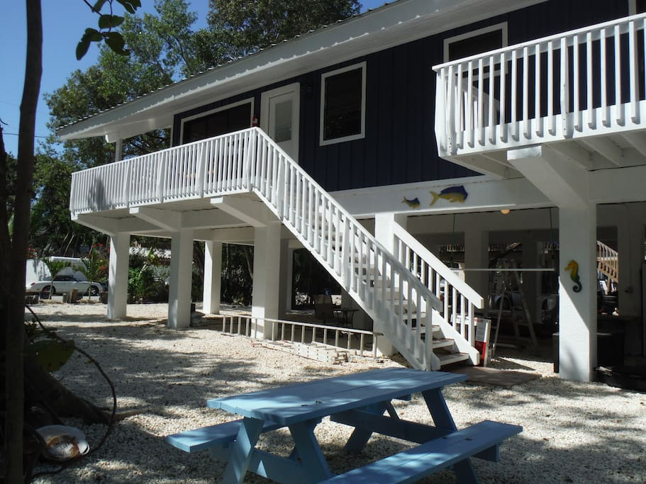 Large yard with picnic table and outdoor shower