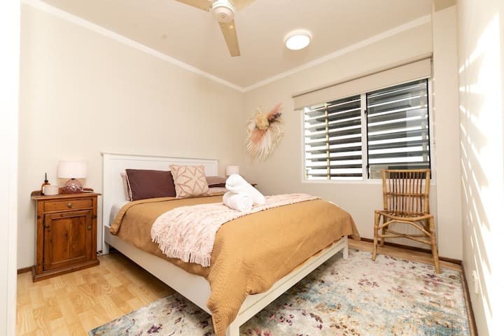 Quaintly styled second bedroom with louvres for fresh air.