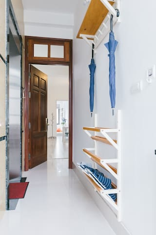 Hallway with shoe rack.