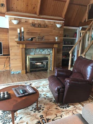 View of livingroom  from loveseat.