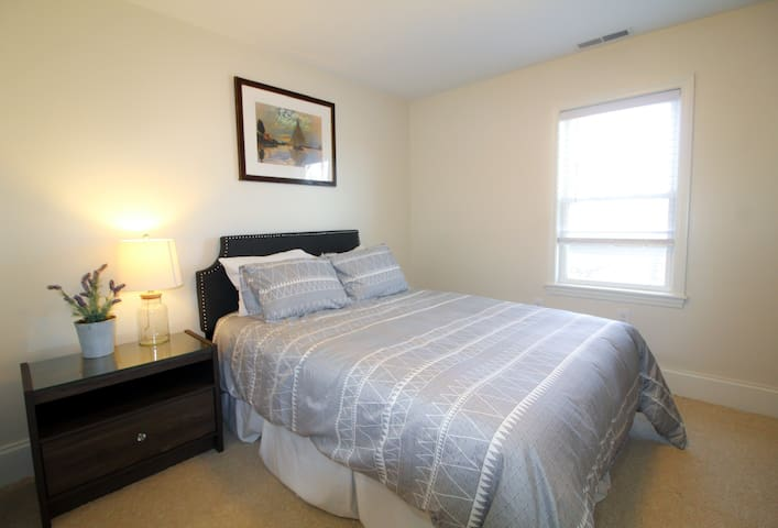 1st bedroom - Full size bedroom with dresser and closet space