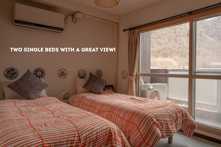 Two single beds with a great view for our guests.