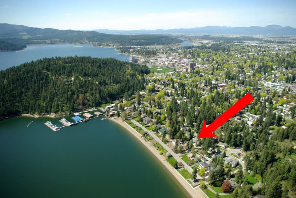 Aerial showing home location to lake and town.