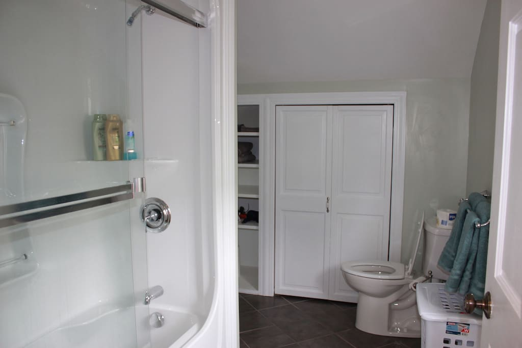 Bathroom with full size tub.  Furnished with towels.