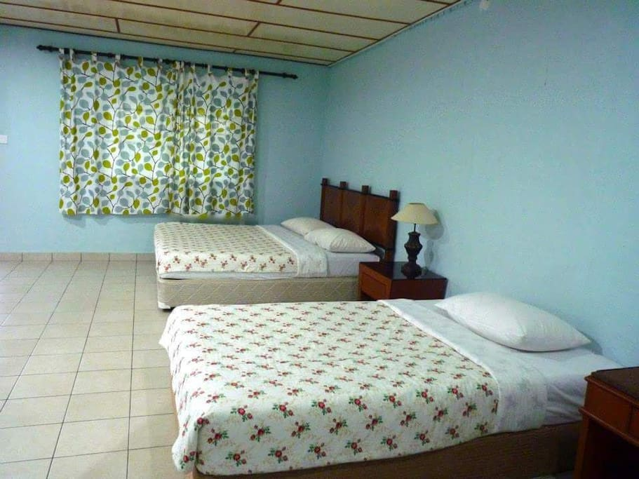 Deluxe room with 1 king bed and 1 single bed with attached bathroom