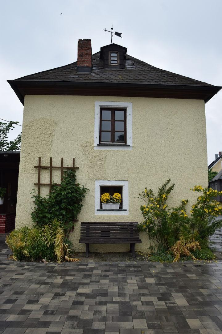 Ferienhof Schricker (Marktleuthen), Ferienhäuschen mit Kachelofen