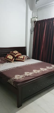 Bedroom with double bed and attach washroom