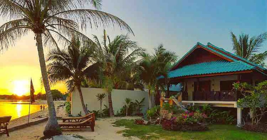 Front villa and beach at sunset