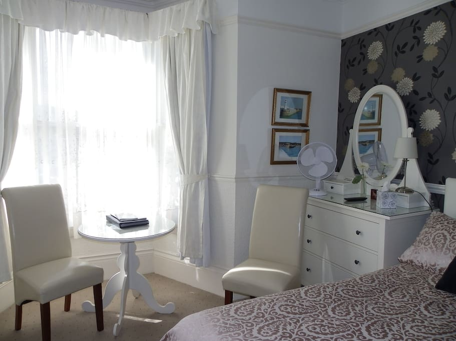 Comfy seating and table - lovely large bay window (secondary glazing)