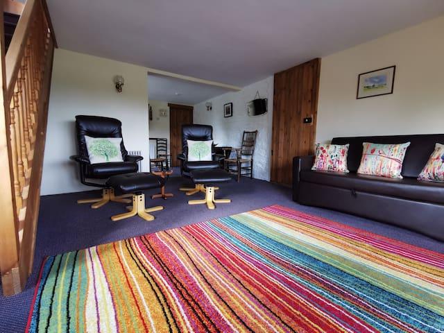 Cwtch Cottage's dual aspect comfy lounge