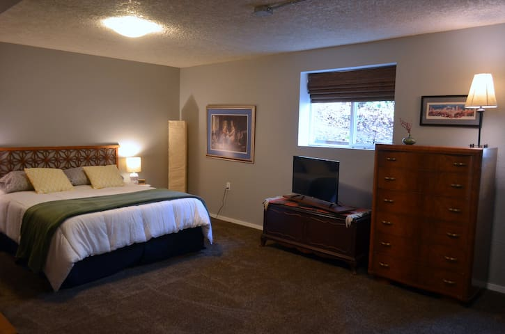 Queen bed with tv, dresser, 2 large windows