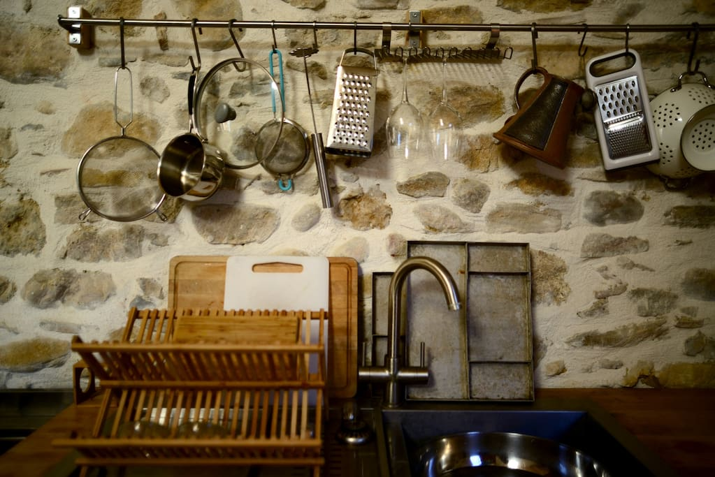 The kitchen is fully equipped with all of the utensils and condiments you could need to cook up a storm, as well as a small convection oven, a large 6-burner Glem oven and stove-top, and a small dishwasher and fridge.