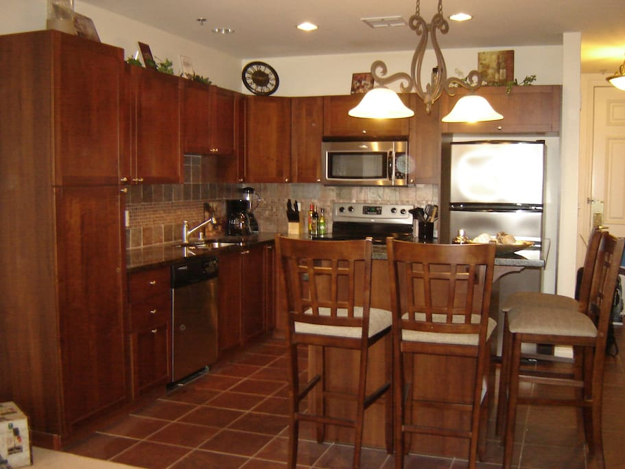 Contemporary  kitchen with stainless steel appliances and granite counters.