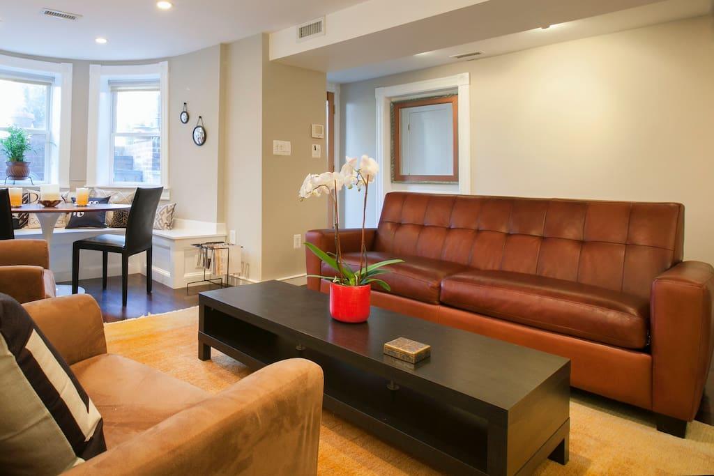 Room & Board leather sofa with full sleeper.