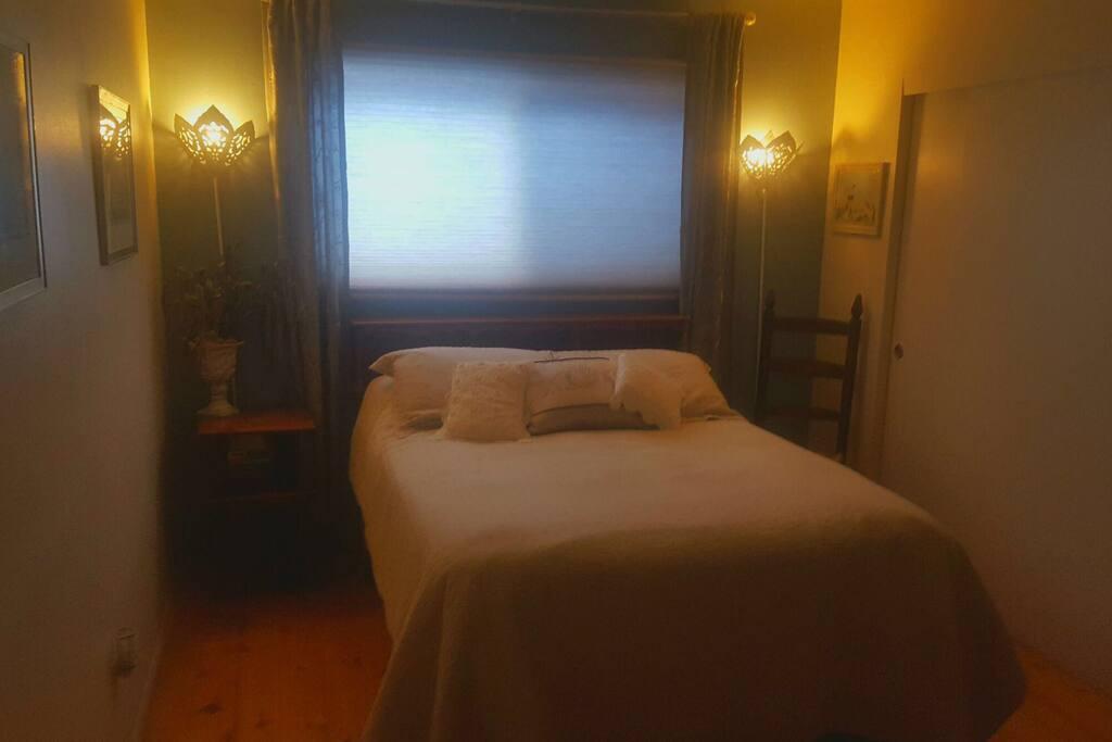 Amazingly comfortable bed. Bathroom is directly across the hallway.,