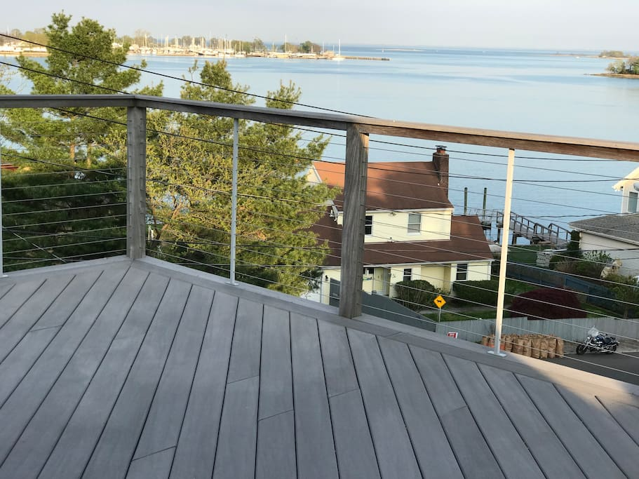 Large roof deck on third floor looks over to Long Island Sound.