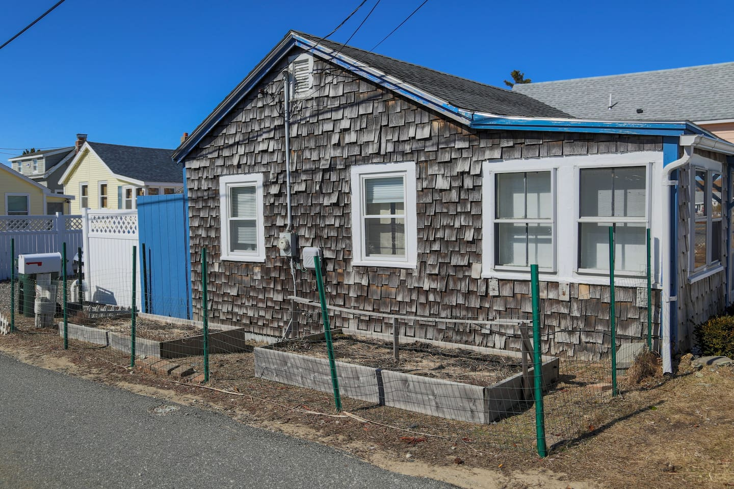 A side view of the beach cottage. During the summer, you may see wild flowers or tomatoes.