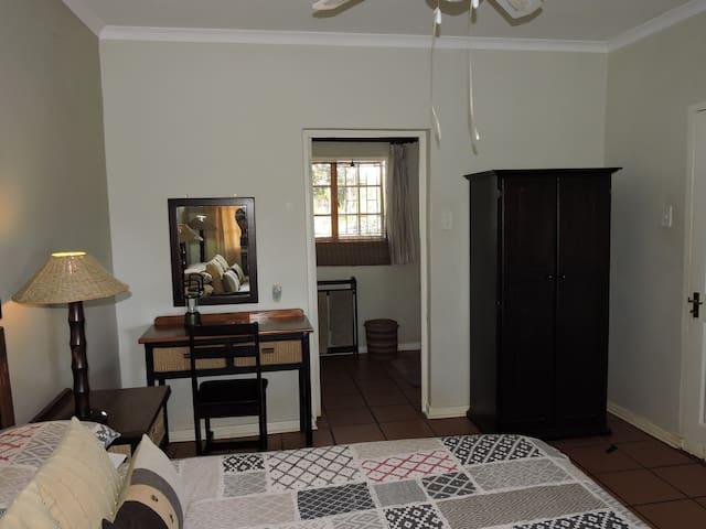 Main Bedroom en-suite with a bath