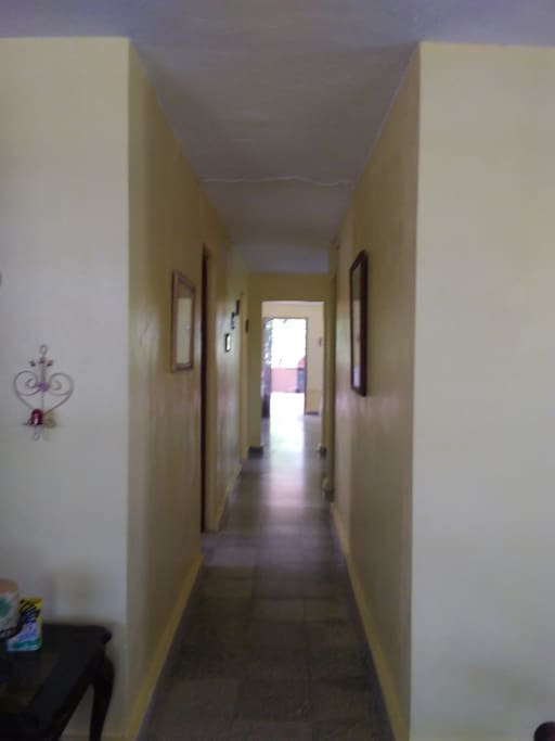 Hallway from Livingroom to rooms & Kitchen