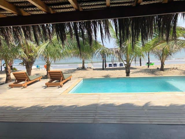 Exclusive beach front villa in private condominium